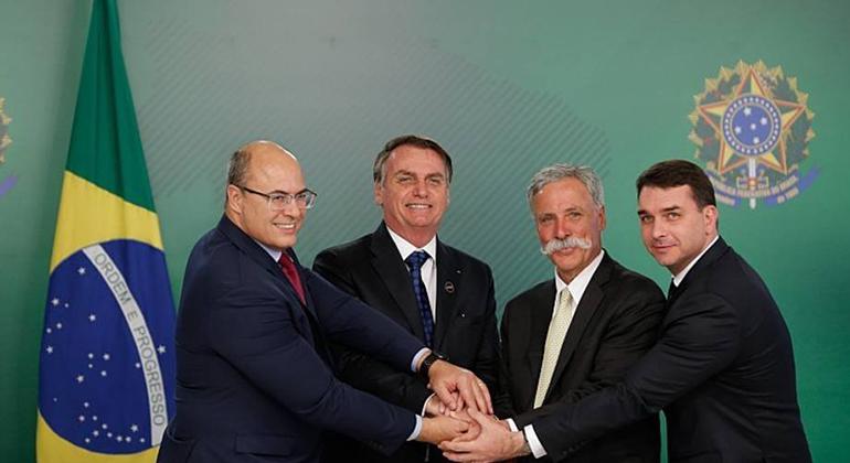 Bolsonaro, entre Witzel e Carey, garante 99% de chances de levar a F-1 para o Rio (Gabriela Bilo/Estadão)